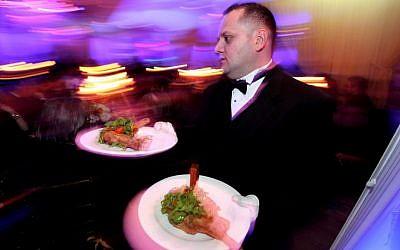 Illustrative image of a waiter bringing out food at a restaurant on December 5, 2010. (Moshe Shai/FLASH90)