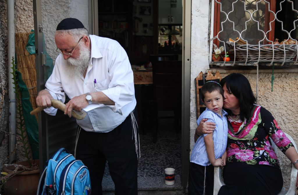 Moshe Holtzberg seen on his first day at first grade in the city of Migdal Haemek on August 26,2012. Rabbi Gavriel Noach Holtzberg and his wife, Rivka, who was five months pregnant, were killed during the November 2008 Mumbai attacks by Pakistani Islamic terrorists. Their two-year-old son Moshe survived the attack after being rescued by his Indian nanny, Sandra Samuel. (Avishag Shaar Yashuv/Flash90)
