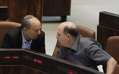 Education Minister Naftali Bennett (L) speaks with Defense Minister Moshe Ya'alon in the Israeli parliament on June 5, 2013. (Miriam Alster/FLASH90)