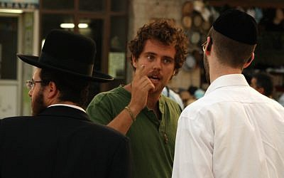 A secular Jew talks to an ultra-Orthodox man about the Green Line in front of City Hall in Jerusalem, June 5, 2013. (Lucie March/Flash 90)