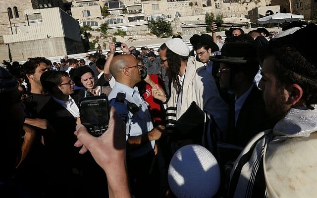 Orthodox Jewish men blow whistles as they try to disturb the monthly prayer service of the Women of the Wall at the Western Wall, August 7, 2013. (Miriam Alster/Flash90)