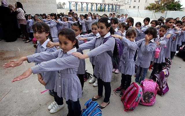 Illustrative photo: Palestinian students seen on their first day of the new school year in the West Bank city of Ramallah, on August 25, 2013. (Issam Rimawi/FLASH90)