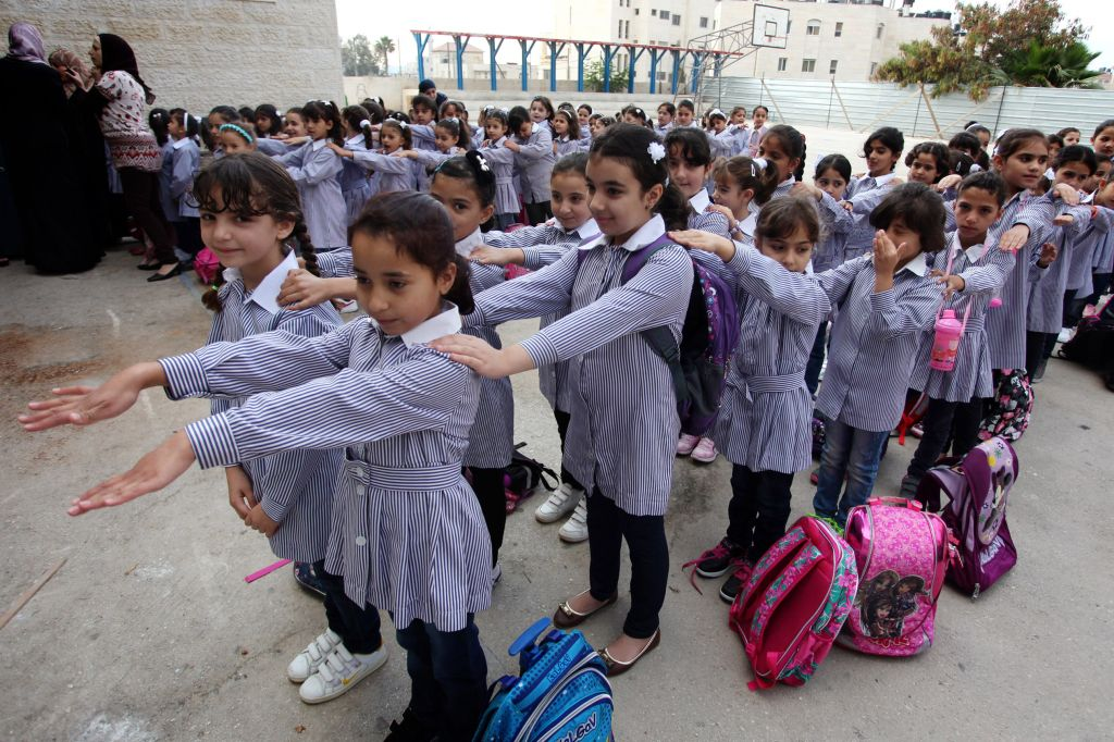 New Palestinian textbooks 'teach students to be martyrs