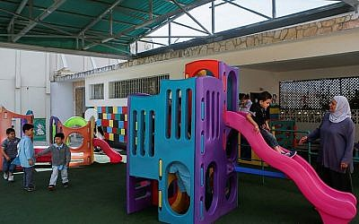 Illustrative: Young children play on the playground of the kindergarten of the convent of the Comboniennes sisters, in the East Jerusalem neighborhood of Ras Al-Amud. May 19, 2014. (Miriam Alster/FLASH90)