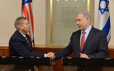 Prime Minister Benjamin Netanyahu meets with US senator Senator Lindsey Graham in Jerusalem during a previous visit by Graham on December 27, 2014 (Amos Ben Gershom/GPO)