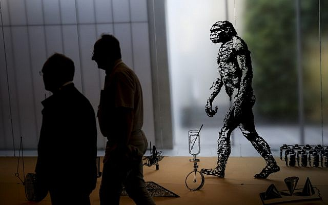 Visitors walk past an evolution exhibit at the Israel Museum in Jerusalem, on June 23, 2015 (Hadas Parush/Flash90)