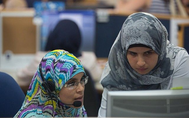 Israeli Bedouin women working at a Bezeq customer service center on July 27, 2015. The call center is located in a mosque, in the Arab town of Hurra. The women have been employed through the Rayan employment center in Rahat. Employment experts want to focus on quality career paths in addition to entry-level positions. (Miriam Alster/Flash90)