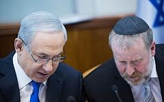 Prime Minister Benjamin Netanyahu, left, confers with then-cabinet secretary Avichai Mandelblit during a weekly cabinet meeting in Jerusalem, on December 20, 2015. (Yonatan Sindel/Flash90)