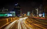 Illustrative: A long exposure photograph of traffic on the Ayalon Highway through Tel Aviv, December 19, 2015. (Esther Rubyan/Flash 90)