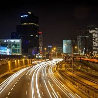 Illustrative: A long exposure photograph of traffic on the Ayalon Highway through Tel Aviv, December 19, 2015. (Esther Rubyan/Flash 90)