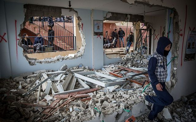 Palestinians inspect the damage in the home of Baha Allian, which was demolished by Israeli security forces in the East Jerusalem neighborhood of Jabel Mukabar, as part of Israel's punishment for a terror attack, on January 4, 2015. (Hadas Parush/Flash90)