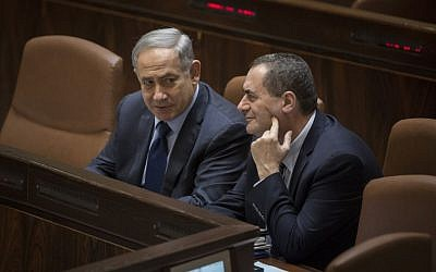 File: Prime Minister Benjamin Netanyahu talks with Transportation Minister Yisrael Katz during a Knesset plenary session, February 8, 2016. (Hadas Parush/Flash90)