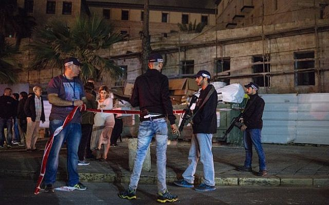 Israeli police and medics at the scene of a stabbing attack in Jaffa where one person was killed and 11 others were wounded on March 8, 2016. (Matanya Tausig/Flash90)
