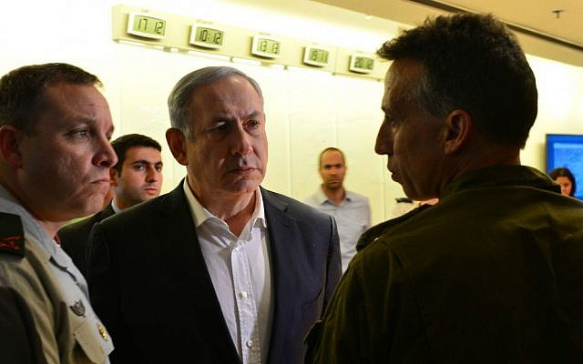 Prime Minister Benjamin Netanyahu at the Foreign Ministry situation room in Jerusalem following the suicide bombing attack in Turkey in which three Israelis were killed and another 11 wounded, March 19, 2016. (Kobi Gideon/GPO)