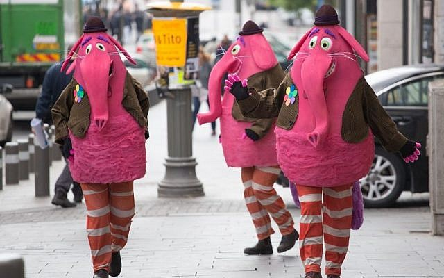 Israelis dressed up in elephant costumes walk down a Jerusalem street ahead of the Jewish holiday of Purim on March 22, 2016. (Yonatan Sindel/Flash90)