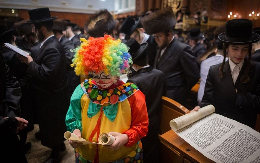Ultra-Orthodox Jewish men and children read the Scroll of Esther, which tells the story of the Jewish festival of Purim, at a Jerusalem yeshiva on March 24, 2016. (Yonatan Sindel/Flash90)