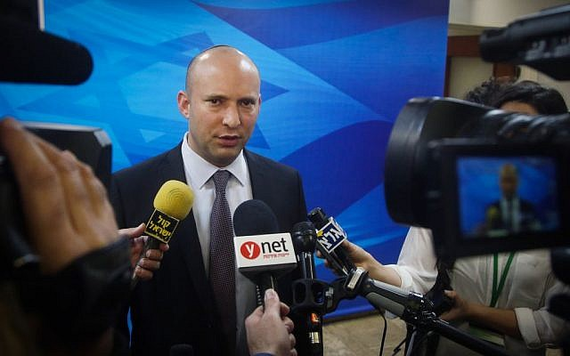 Education Minister Naftali Bennett speaks to reporters before the weekly cabinet meeting in Jerusalem on Sunday, March 27, 2016. (Marc Israel Sellem/Pool)