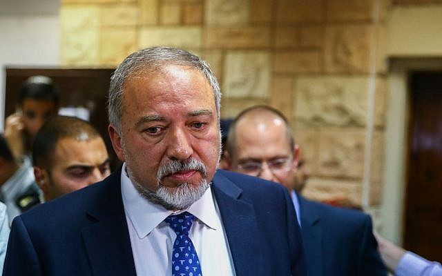 Knesset member Avigdor Liberman arrives at a military court to show support for a soldier who was charged for killing a wounded Palestinian assailant, on Tuesday, March 29, 2016 (Flash90)