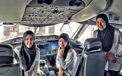 The all-female flight-deck crew of a Royal Brunei Airlines plane. From left to right, Captain Sharifah Czarena Surainy, Senior First Officer Dk Nadiah Pg Khashiem and Senior First Officer Sariana Nordin  became the first all-female crew for the airline when they flew to Saudi Arabia, February 23, 2016. (Royal Brunei Airlines)