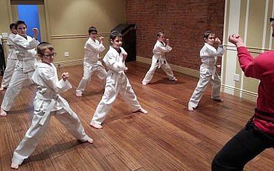 Mordechai Genut, founder of Frum Karate, instructing some beginners' students. (Courtesy of Mordechai Genut)