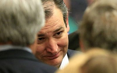 Republican presidential candidate Sen. Ted Cruz, R-Texas, listens to supporters at a caucus site, Saturday, March 5, 2016, in Wichita, Kansas. (AP Photo/Orlin Wagner)