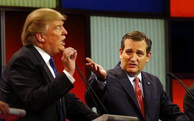 Republican presidential candidates Donald Trump and Sen. Ted Cruz, R-Texas, argue a point during a Republican presidential primary debate at Fox Theatre in Detroit, Michigan, Thursday, March 3, 2016. (AP Photo/Paul Sancya)