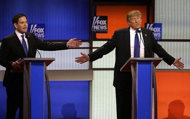 Senator Marco Rubio and businessman Donald Trump argue a point during a Republican presidential primary debate in Detroit, Michigan, on March 3, 2016. (AP/Carlos Osorio)