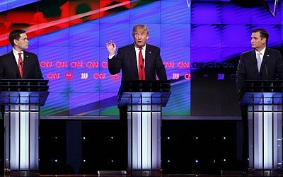 Republican presidential candidate Donald Trump, center, speaks as candidates Sen. Marco Rubio, R-Florida, left, and Sen. Ted Cruz, R-Texas, right, listen, during the Republican presidential debate sponsored by CNN, Salem Media Group and the Washington Times at the University of Miami in Coral Gables, Florida, Thursday, March 10, 2016. (AP Photo/Wilfredo Lee)