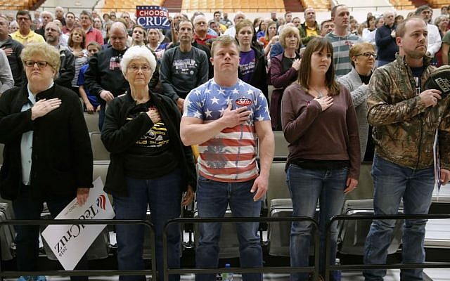 Wichita, Kansas residents prepare for the pledge of allegiance at a caucus site, Saturday, March 5, 2016, in Wichita. (AP Photo/Charles Rex Arbogast)