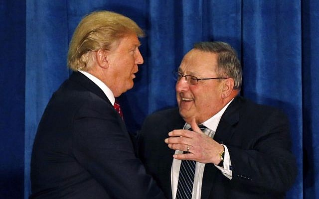 In this March 3, 2016, photo, Republican presidential candidate Donald Trump is welcomed to the stage by Maine Gov. Paul LePage at campaign stop in Portland, Maine. (AP Photo/Robert F. Bukaty)