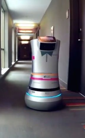 "A robot ""botlr"" named Relay, on display at an Intel event last June, has already been deployed within the Crown Plaza San Jose-Silicon Valley Hotel and delivers items from the front desk, such as drinks, towels, toothbrushes, etc. (Courtesy)"