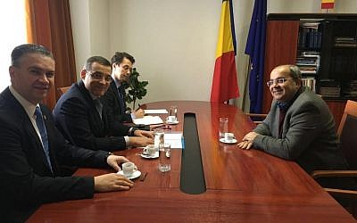 Ahmed Tibi, right, meeting with Romanian lawmakers in Bucharest on March 24, 2016. (Joint List spokesperson)