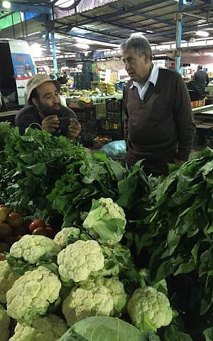 Tables are laden with fresh produce and wild greens of all kinds at Arrabeh's twice-weekly market (Jessica Steinberg/Times of Israel)