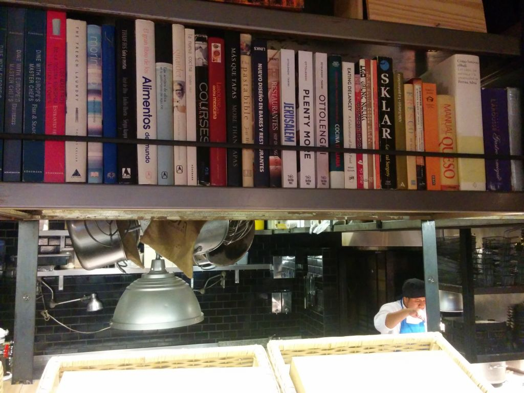 Cookbooks, including Yotam Ottolenghi's Jerusalem, at the Mishiguene restaurant in Buenos Aires (Ilan Ben Zion/Times of Israel staff)