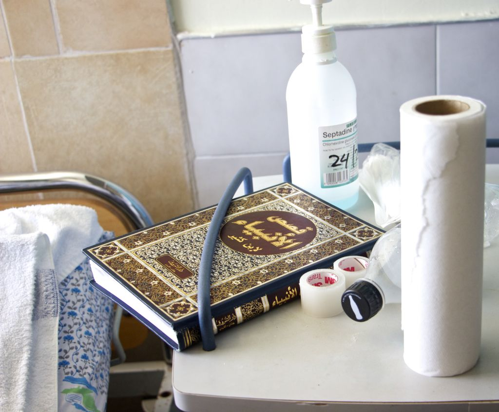 "A copy of the ""Story of the Prophets"" near the bedside of a Syrian patient in Ziv hospital. March 10, 2016. (Dov Lieber / Times of Israel)"