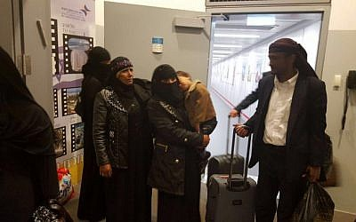 The final group of Jewish immigrants from Yemen arrives in Israel accompanied by an ancient Torah scroll, March 20, 2016. (Arielle Di-Porto/The Jewish Agency for Israel)