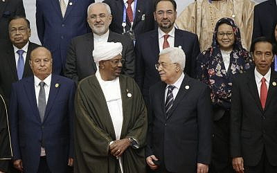 "Indonesian President Joko ""Jokowi"" Widodo, front row right, joins other participants, first row from left, Yemen's President Abdo Rabbo Mansour Hadi, Sudan's President Omar al Bashir, Palestinian President Mahmoud Abbas, and second row from left, Bangladesh's Foreign Minister Abul Hassan Mahmood Ali, Iran's Foreign Minister Mohammad Javad Zarif, Afghanistan's Foreign Minister Salahuddin Rabbani and Indonesian Foreign Minister Retno Marsudi for a group photo session at the extraordinary Organization of Islamic Cooperation (OIC) summit on Palestinian issues in Jakarta, Indonesia, Monday, March 7, 2016. (AP Photo/Dita Alangkara)."
