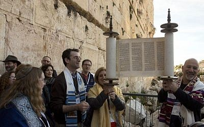 In this photo taken Thursday, Feb. 25, 2016, American Reform Rabbi Zachary Shapiro, center left, and other American and Israeli Reform rabbis pray at the Western Wall. (AP Photo/Sebastian Scheiner)