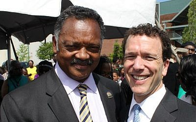 Rabbi Micah Greenstein (right) led prayer at a dedication ceremony, which included Rev. Jesse Jackson, for 'Dr. M. L. King Jr. Ave.' in downtown Memphis, April 4, 2012, 44 years after Dr. King was killed in Memphis. (courtesy)