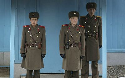 In this February 22, 2016 file photo, North Korean soldiers guard the truce village of Panmunjom at the Demilitarized Zone (DMZ) which separates the two Koreas, in Panmunjom, North Korea.  (AP/Wong Maye-E, File)