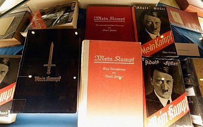 "Historic copies of Adolf Hitler's ""Mein Kampf"" are displayed during the book launch of a new critical edition at the Institut fuer Zeitgeschichte in Munich, Germany, January 8, 2016. (Johannes Simon/Getty Images)"