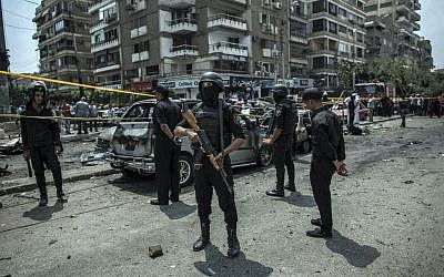 File: Egyptian policemen stand guard at the site of a June 29, 2015 bombing in Cairo that killed Egypt's top prosecutor, Hisham Barakat, who oversaw cases against thousands of Islamists. (AP/Eman Helal, File)