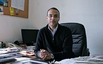This Dec. 7, 2011 photo shows investigative journalist Hossam Bahgat in his office at the Egyptian Initiative for Personal Rights in Garden City, Cairo, Egypt. (Sarah Rafea via AP, File)