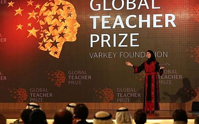 Palestinian primary school teacher Hanan al-Hroub speaks after she won the second annual Global Teacher Prize, in Dubai, United Arab Emirates, Sunday, March 13, 2016. (AP/Kamran Jebreili)