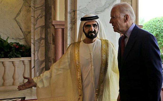 Sheikh Mohammed Bin Rashid Al Maktoum, the ruler of Dubai and UAE Vice President receives U.S. Vice President Joe Biden, right, in his palace after his arrival in Dubai, United Arab Emirates, Tuesday, March 8, 2016. (AP Photo/Kamran Jebreili)