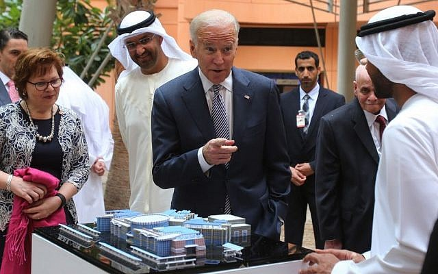 Joe Biden, the U.S. Vice President, points to one of the Masdar City employees as Sultan Ahmed Al Jaber, UAE minister of state and the chairman of Masdar City, 3rd left, looks on, in Abu Dhabi, United Arab Emirates, Monday, March 7, 2016. (AP Photo/Kamran Jebreili)