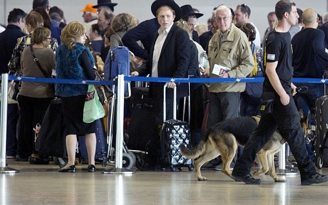 An Israeli airport security guard patrols with a dog in Ben Gurion airport near Tel Aviv, Israel, Tuesday, March 22, 2016. (AP Photo/Ariel Schalit)
