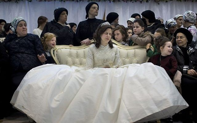 A Jewish Bride Sits With Family Members In The Women S Section During Her Wedding To