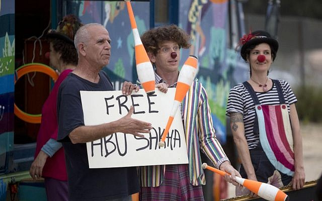 Israeli circus artists protest for the release of Palestinian detainee Abu Sakha, a circus performer on a 6-month administrative detention, outside the Megiddo prison northern Israel, Wednesday, March 2, 2016. (AP Photo/Sebastian Scheiner)