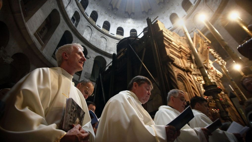 Christian clergymen stand during the Washing of the Feet ceremony at the Church of the Holy Sepulchre, traditionally believed by many to be the site of the crucifixion and burial of Jesus Christ, in Jerusalem's Old City, Thursday, March 24, 2016. (Mahmoud Illean/AP)